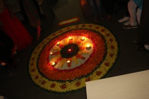 Decorating the house with rangolis and diyas